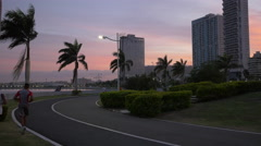 Running in Cinta Costera park at dusk in Panama Stock Footage