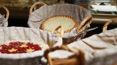 Cakes and pies in wicker backets Stock Footage