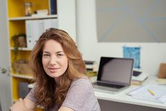 Young Woman at her Study Room Smiling at Camera Stock Photos