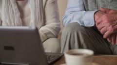 Two elderly person using laptop in living room close up 4K Stock Footage