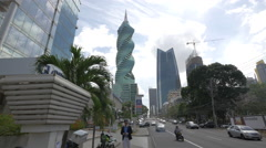 Traffic on the street near the F&F Tower and Soho Mall in Panama Stock Footage
