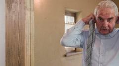Grandpa put a tie around neck 4K Stock Footage