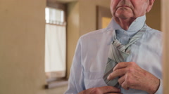 Old person tie a tie close up 4K Stock Footage