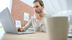 Man websurfing with laptop computer at home Stock Footage