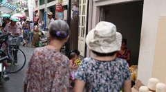 Wide angle - people walk at morning market Stock Footage