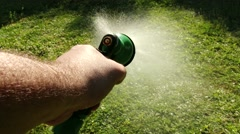 Stock Video Footage of 4K Man Watering Lawn by Spraying Hose 2 POV