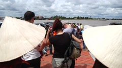 Tourists board boat at mekong river Stock Footage
