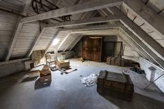 Old attic with hidden secrets of an abandoned house Stock Photos