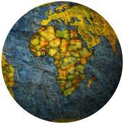 ghana flag on globe map - stock illustration