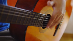 Fingers play on strings close up sliding 4K Stock Footage