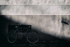 Cyclists at an old wall with a relief Stock Photos