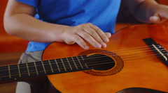 Tapping on strings and guitar body close up 4K Stock Footage