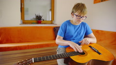 Playing new music on guitar instrument 4K Stock Footage