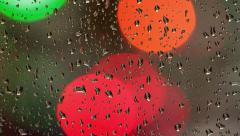 Color lights through the glass with raindrops Stock Footage