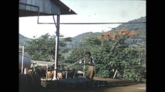 Vintage 16mm film, Malaysia 1952, man working on equipment Stock Footage