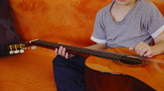 Child set guitar strings close up 4K Stock Footage