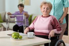 Woman on wheelchair - stock photo