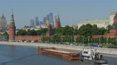 Moscow view from the Vasilevsky bridge to Kremlin Embankment. River barge route. Stock Footage