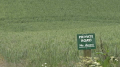 Private property sign near cereal crop. Stock Footage