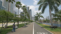 Man walking in Cinta Costera park in the afternoon in Panama City Stock Footage