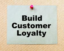 Build Customer Loyalty written on paper note pinned with red thumbtack - stock photo