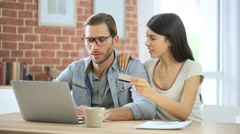 Couple at home e-shopping on internet - stock footage