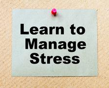 Learn To Manage Stress written on paper note pinned with red thumbtack - stock photo