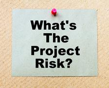 What's The Project Risk? written on paper note pinned with red thumbtack  - stock photo