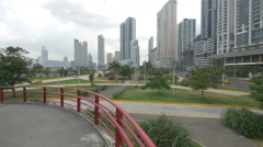 Panama City seen from the pedestrian bridge of Cinta Costera Stock Footage