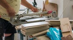 Professional tiler cutting ceramic tiles Stock Footage