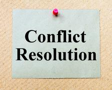 Stock Photo of Conflict Resolution written on paper note pinned with red thumbtack
