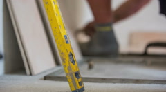 Balance instrument with tiler working in background Stock Footage