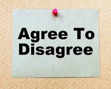 Agree To Disagree written on paper note pinned with red thumbtack Stock Photos