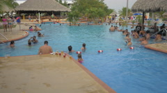 Children and adults swimming at Playa Blanca Resort, Panama Stock Footage