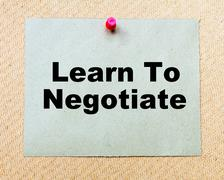 Learn To Negotiate written on paper note pinned with red thumbtack - stock photo