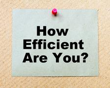 How Efficient Are You? written on paper note pinned with red thumbtack - stock photo