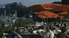 Salzburg 1982: people having a drink in an outdoor bar Stock Footage