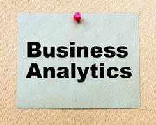 Business Analytics written on paper note pinned with red thumbtack  - stock photo