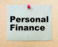 Personal Finance written on paper note pinned with red thumbtack Stock Photos