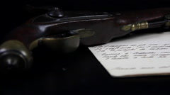 Old gun and old document, dolly Stock Footage
