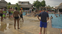Tourists getting ready for a game at Playa Blanca Resort, Panama Stock Footage