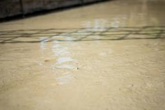 Plasterer concrete cement floor in the home - stock photo