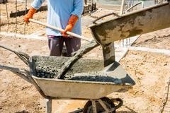 Concrete pouring during commercial concreting floors of buildings in construc - stock photo