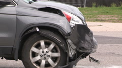 Car accident with car rolled over on it's side at city intersection Stock Footage