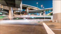 Traffic time lapse under the massive highway system Stock Footage