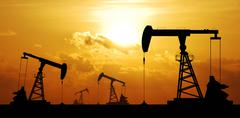 Oil pump oil rig energy industrial machine for petroleum in the sunset backgr Stock Photos