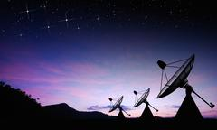 Satellite dish sky sun stars communication technology network image backgroun Stock Photos
