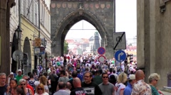 Tourists walking towards or from the Charles Bridge in Prague, Czech Republic - stock footage