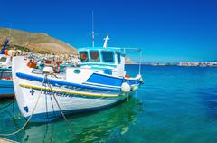 White-blue boat with Greek colors in bay, Greece Stock Photos