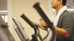 Man exercising on a cross trainer Stock Footage